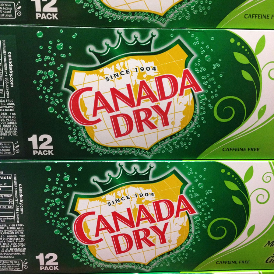Stacked cases of Canada Dry