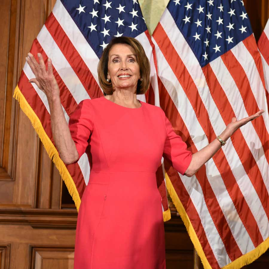 Nancy Pelosi swears in as the Speaker of The House of Representatives in hot pink dress.