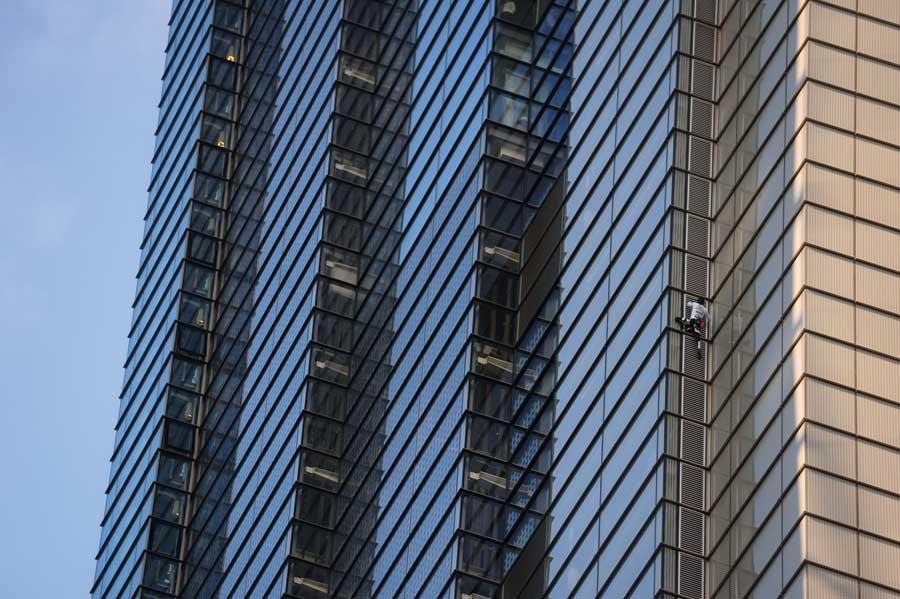 A man scaling a skyscraper.