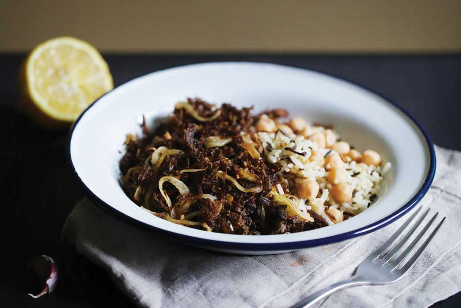 Raison d'être: vaca frita, a traditional Cuban dish, consisting of crispy looking beef, onions, white rice and lentils.
