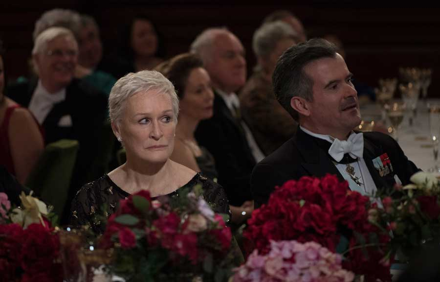 Glenn Close in The Wife listens as her onscreen husband accepts an award.