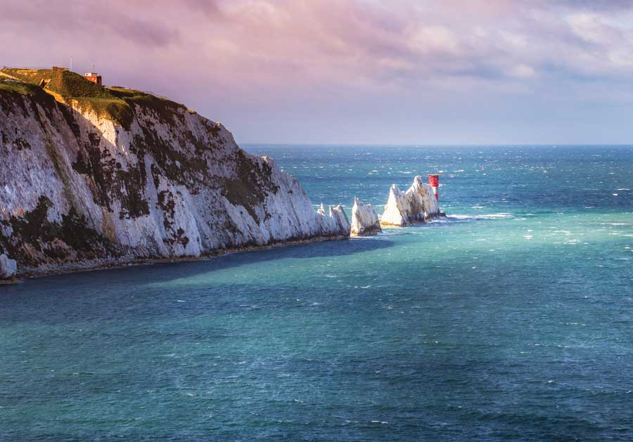 A mountain emerging from the bright blue water at the Isle of Wight.