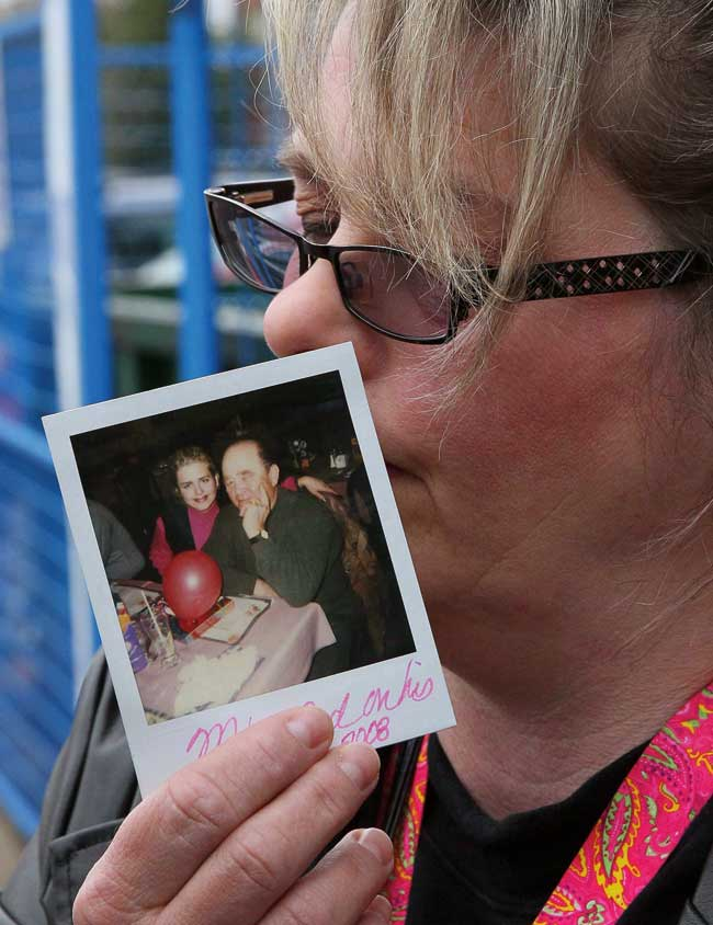 Susan Horvath, daughter of victim Arpad Horvath, holds a photo of her father from his 70th birthday as she speaks to the media outside the court house in Woodstock, Ont., on Friday, April 21, 2017