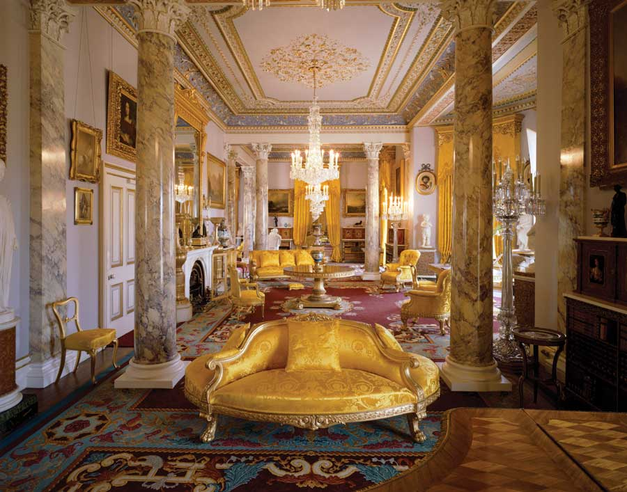 A room at the Osborne House decorated in gold furniture and marble pillars.