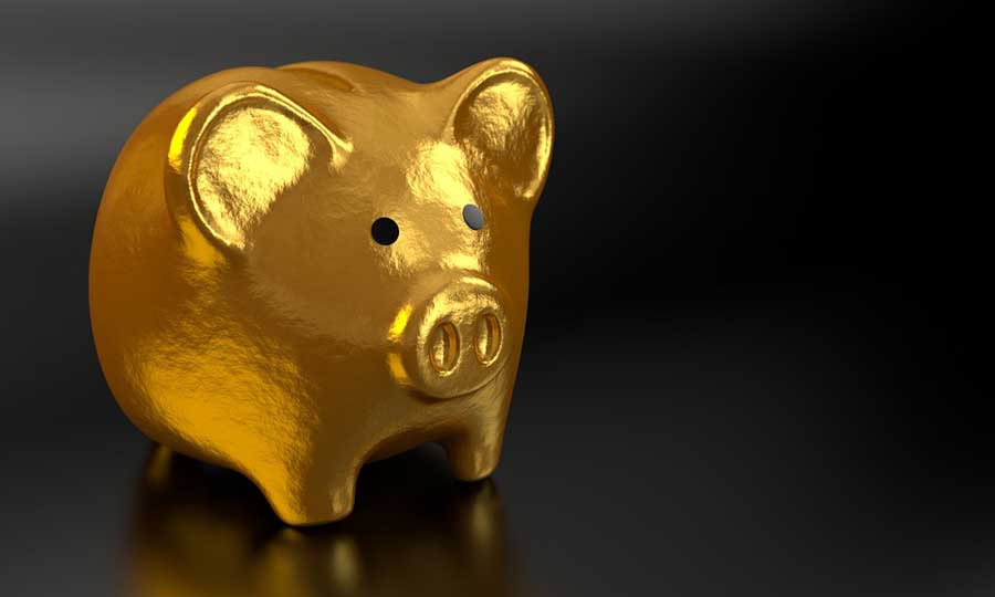 A gold piggy bank on a black background.