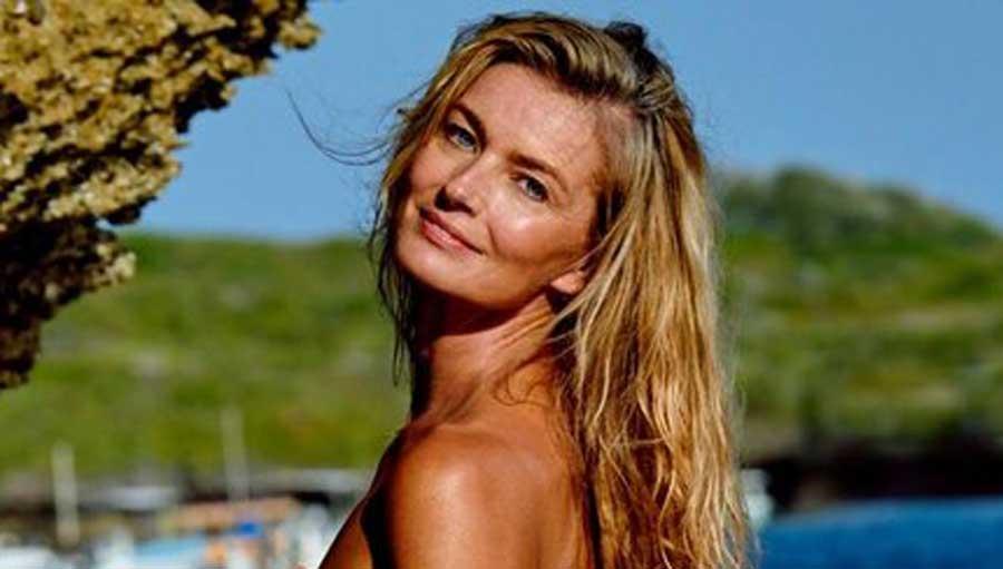 Paulina Porizkova looking over her shoulder topless.