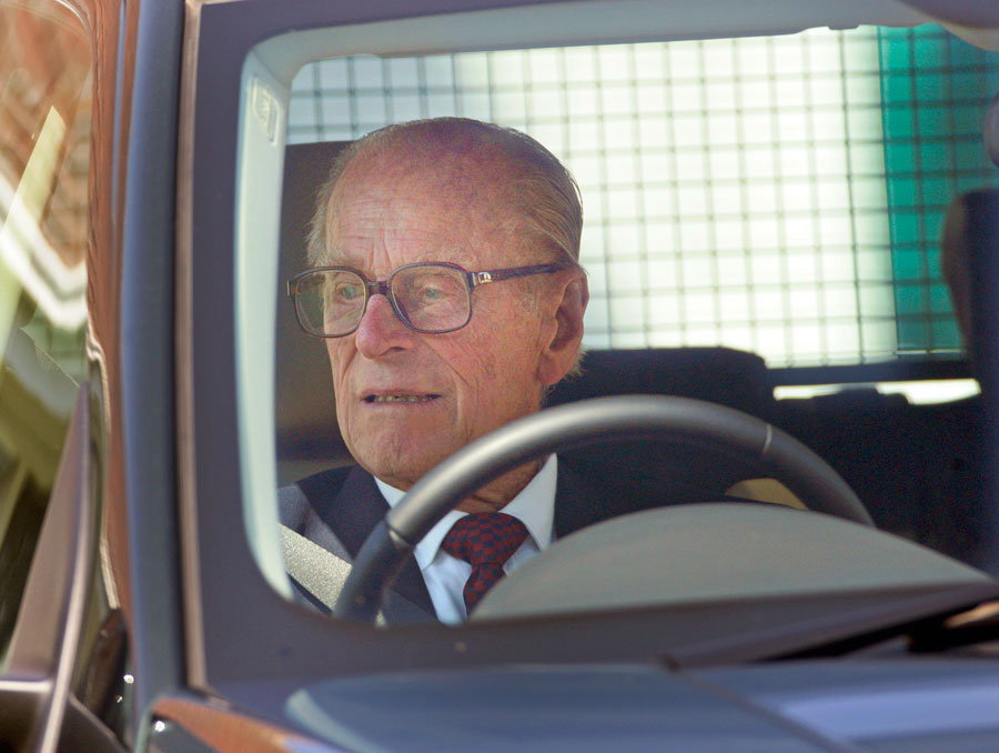 Prince Phillip wearing glasses while driving.