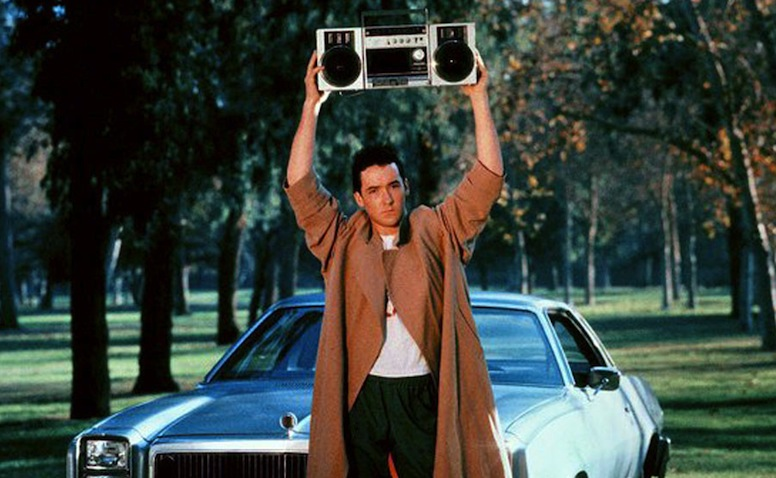 John Cusack holds a boom box over his head in Say Anything.