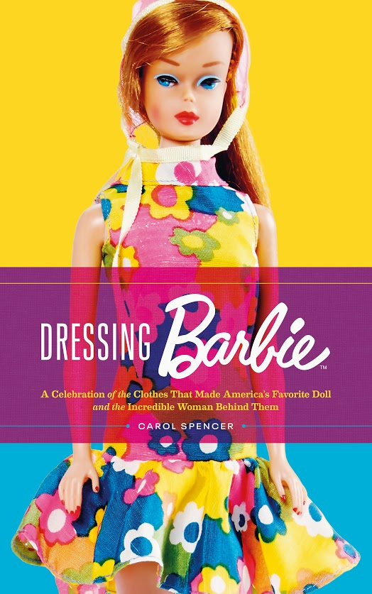 Book cover for Dressing Barbie featuring a red head doll wearing a colourful floral dress.