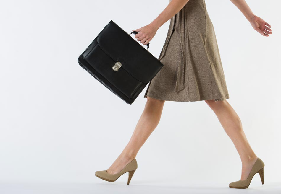 Career woman walking with brief case