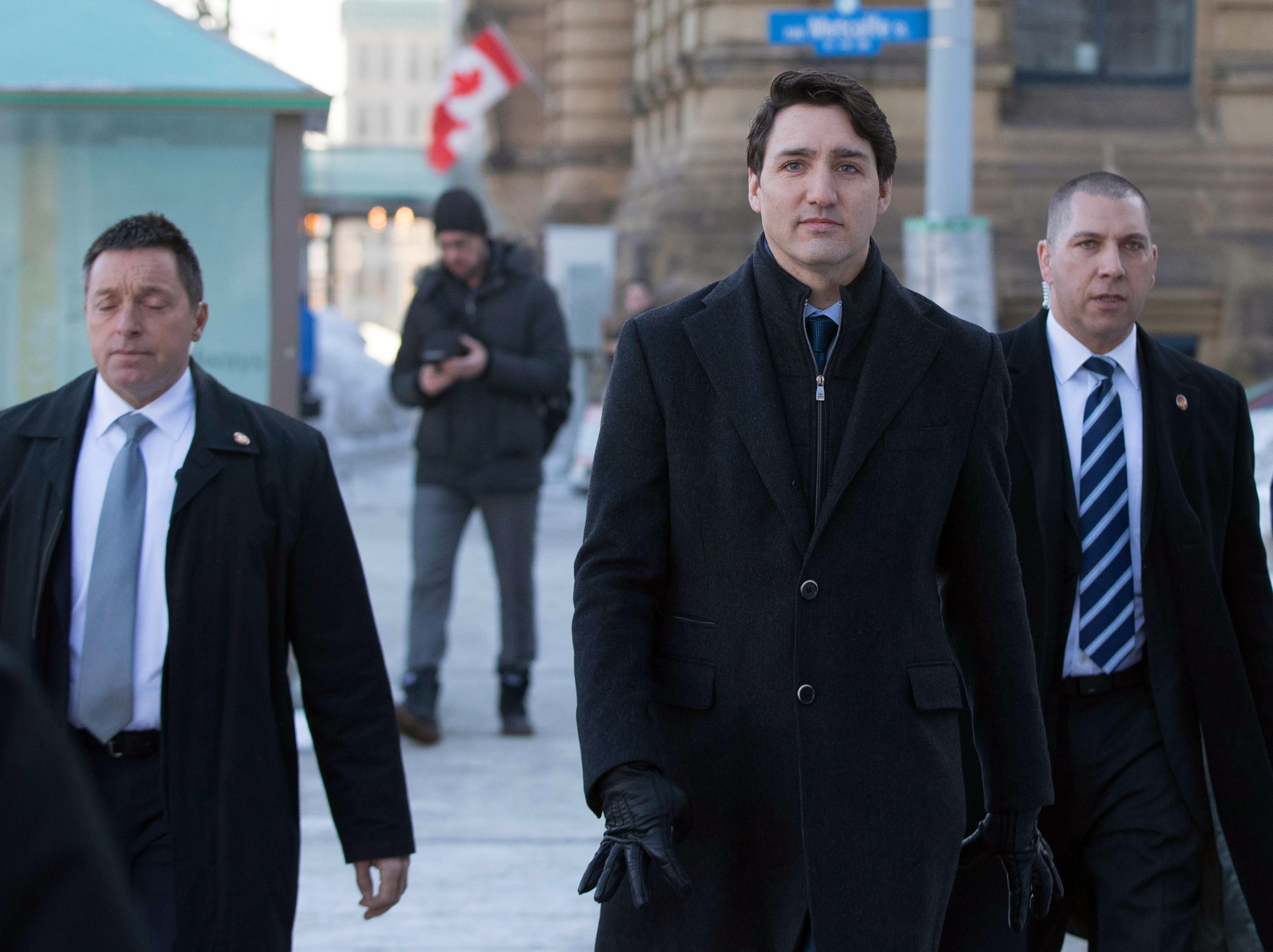 Canadian Prime Minister Justin Trudeau walks to a press conference addressing the SNC-Lavalin scandal from the Prime Minister's office in Ottawa, Ontario, on March 7, 2019. (Photo credit should read LARS HAGBERG/AFP/Getty Images)