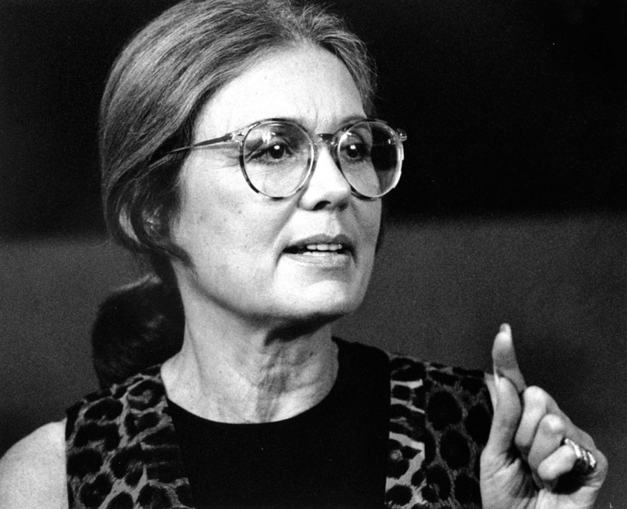 Gloria Steinem with her finger raised as if making a point.