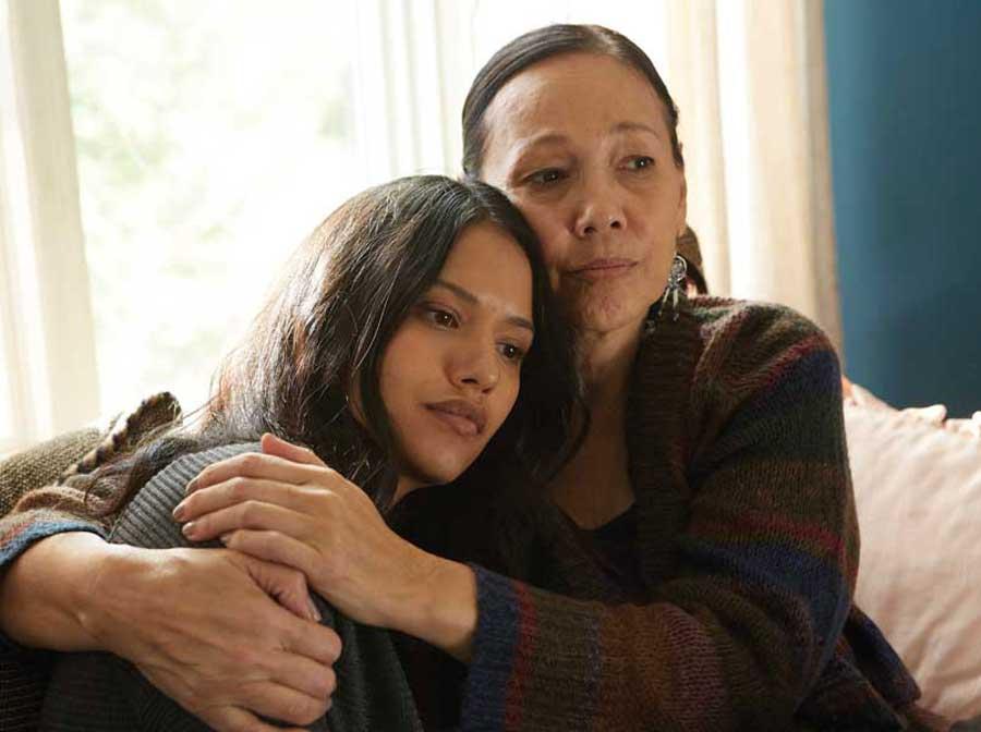 Tina Keeper hugs Tanaya Beatty.