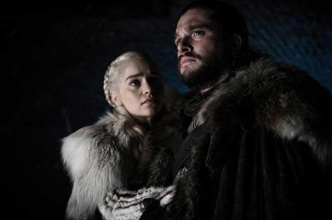 John Snow and Daenerys Targaryen shrouded in darkness.