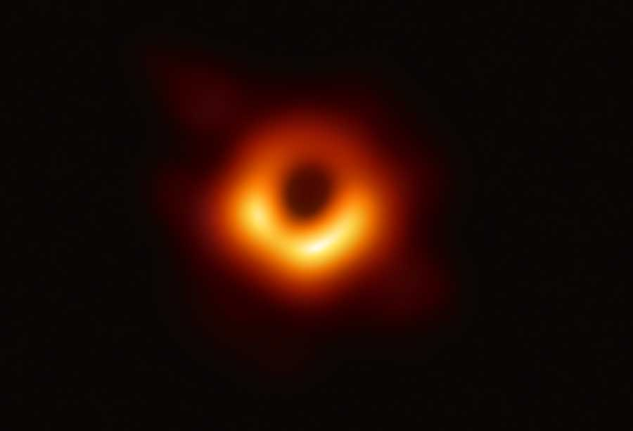 In this handout photo provided by the National Science Foundation, the Event Horizon Telescope captures a black hole at the center of galaxy M87, outlined by emission from hot gas swirling around it under the influence of strong gravity near its event horizon, in an image released on April 10, 2019