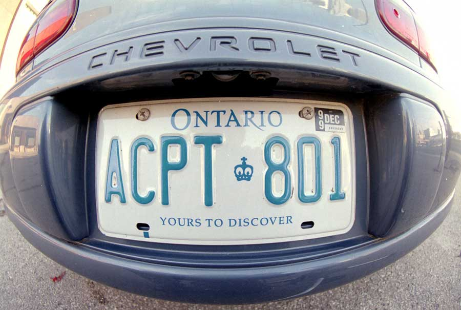 "An Ontario license plate with the current slogan ""Yours to Discover."""