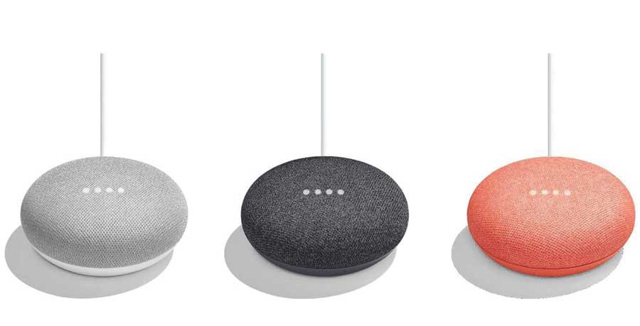 Three google homes in grey, black and peach.