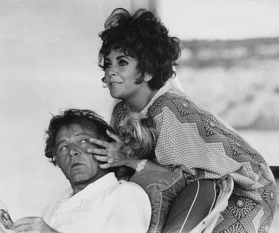 Elizabeth Taylor and her husband, actor Richard Burton on their yacht 'Kalizma' off Capo Caccia on the coast of Sardinia, August 1967. They were both there for the location filming of 'Boom' by Tennessee Williams. (Photo by Express/Hulton Archive/Getty Images)