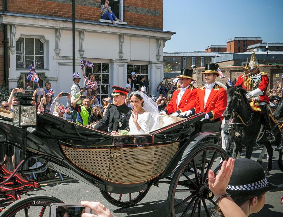 Prince Harry and Meghan Markle in a horse-drawn carriage on their wedding day.