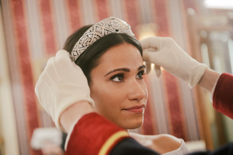 Actress who plays Meghan Markle in newest made-for-tv royal movie wearing a tiara.