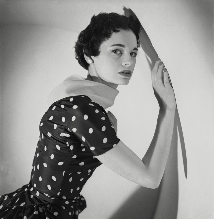 Vogue 1953 Mrs. Leopold Stokowski (aka Gloria Vanderbilt) wearing a polka dot dress with a lifting collar. (Photo by Cecil Beaton/Condé Nast via Getty Images)