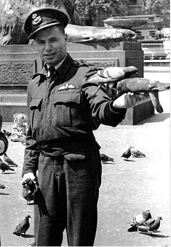 "Flying Officer William ""Bill"" Novick feeding the pigeons in London's Trafalgar Square"