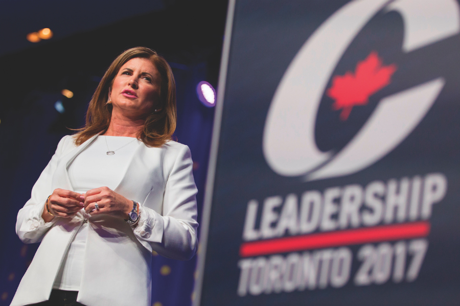 A photo of Rona Ambrose on stage at a Conservative Party event.