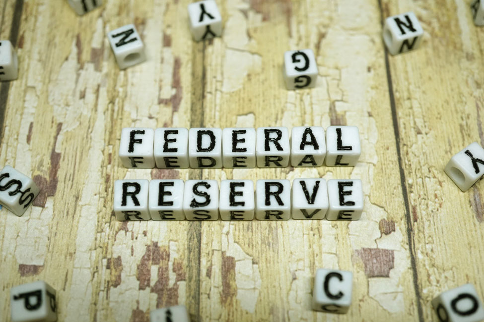 Puzzle pieces spelling out Federal Reserve