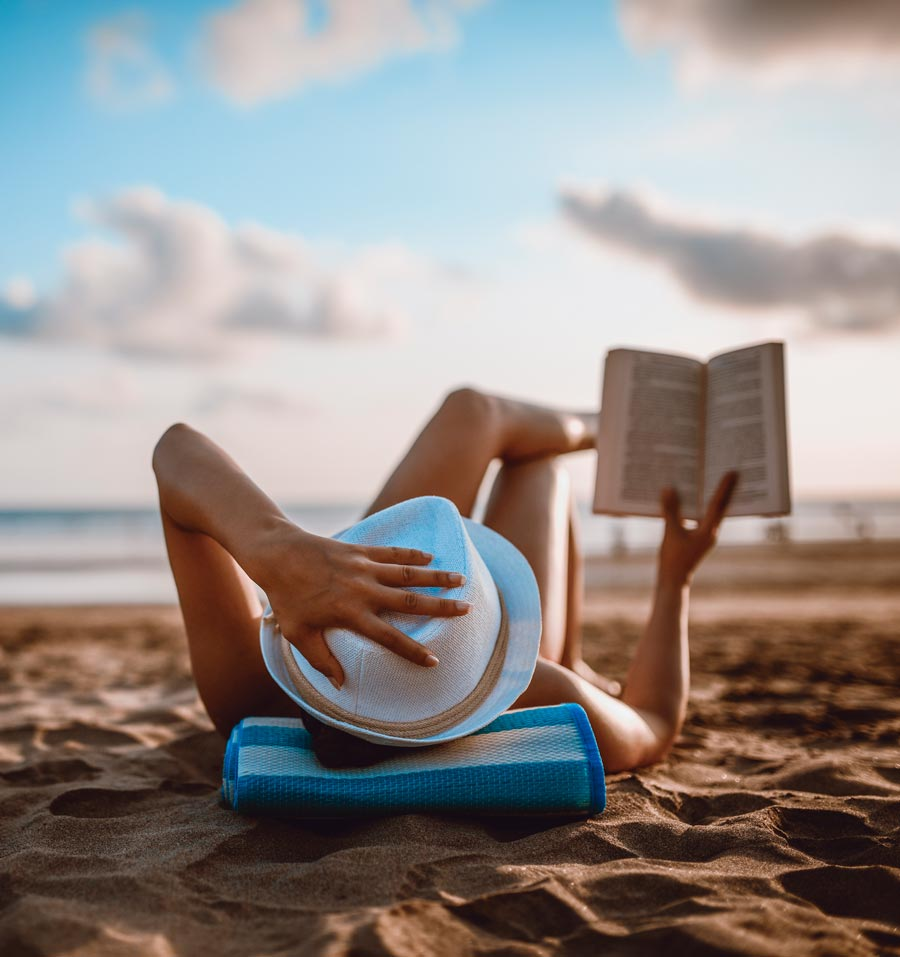 Woman reading on a beach
