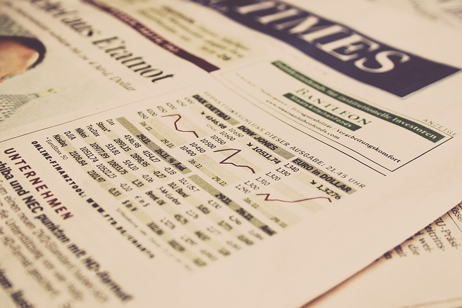 A picture of the financial section of a newspaper, showing stock prices and market levels.
