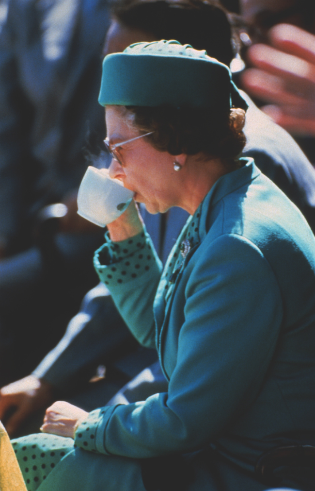 A picture of Her Majesty drinking a cup of tea in London, 1985.