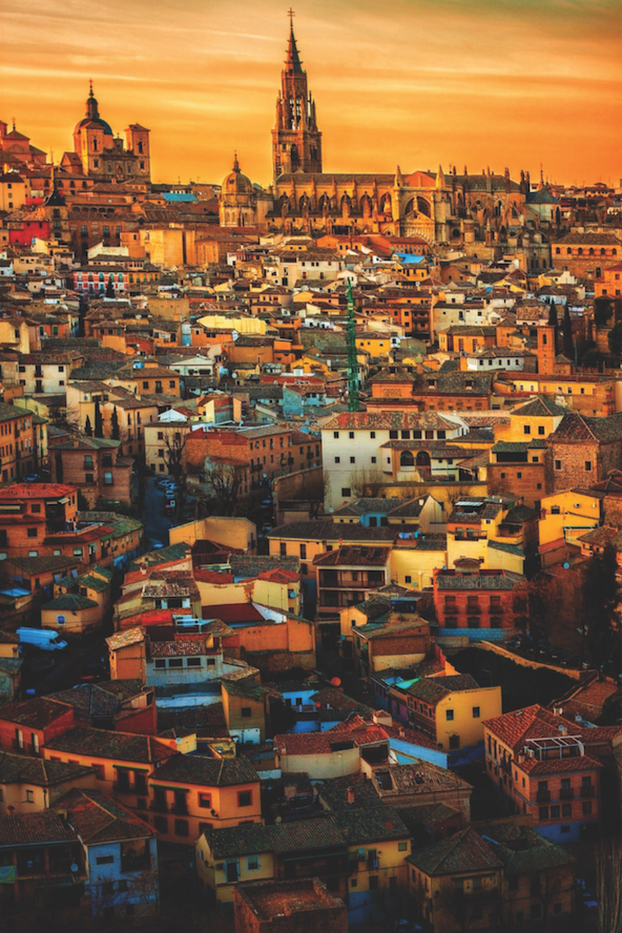 A picture overlooking Madrid, Spain under a bright orange sky.