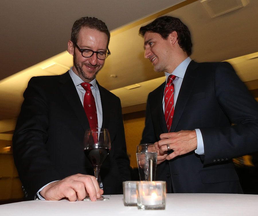 Justin Trudeau and Gerald Butts speak to one another at the Royal York Hotel.