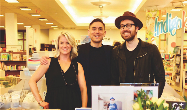 A photo of James Mullinger flanked by Pamela Mullinger and cookbook author and cover subject Dennis Prescott.
