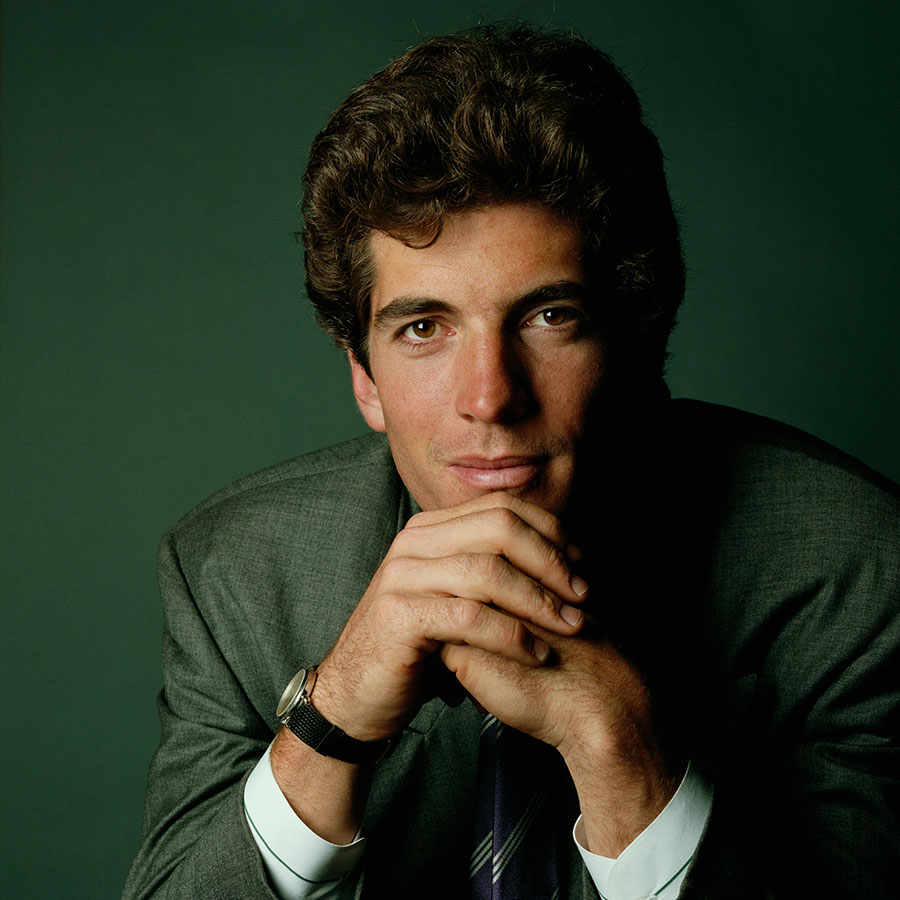 JFK Jr. resting his chin on clasped hands.