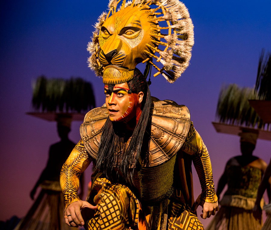 A photo of Mufasa from the stage production of Lion King.