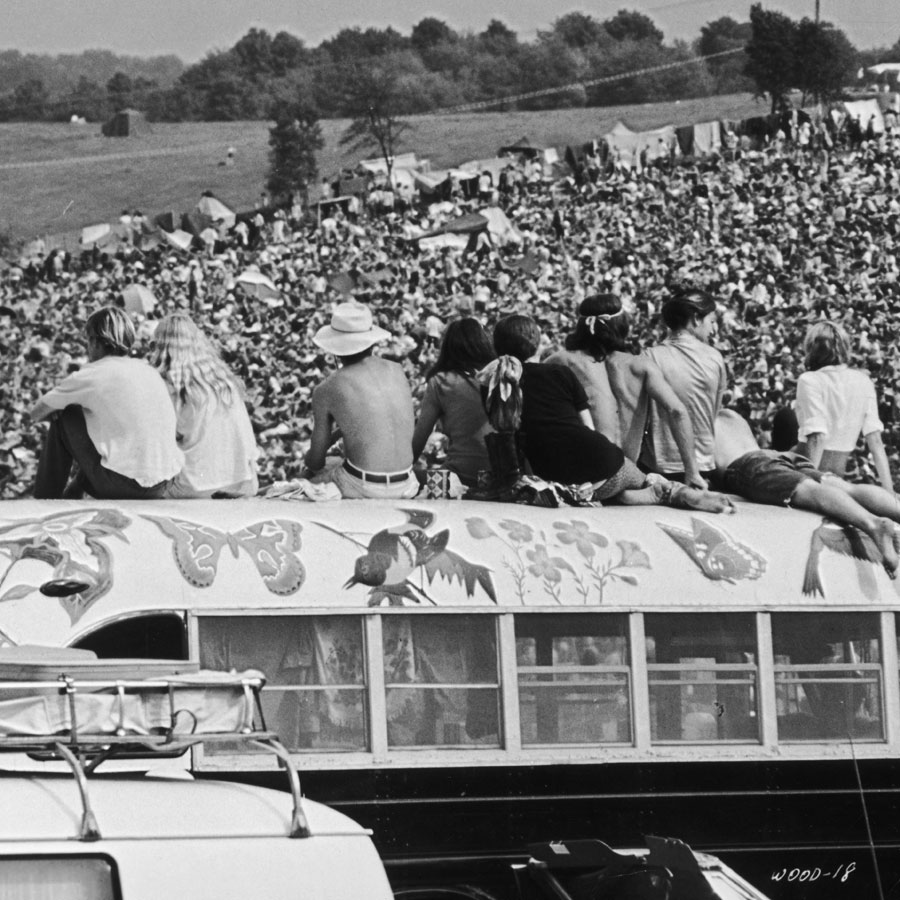Fans sitting on top of a painted bus at the Woodstock Music Festival, Bethel, New York, 15th-17th August 1969. (Photo: Archive Photos/Getty Images)