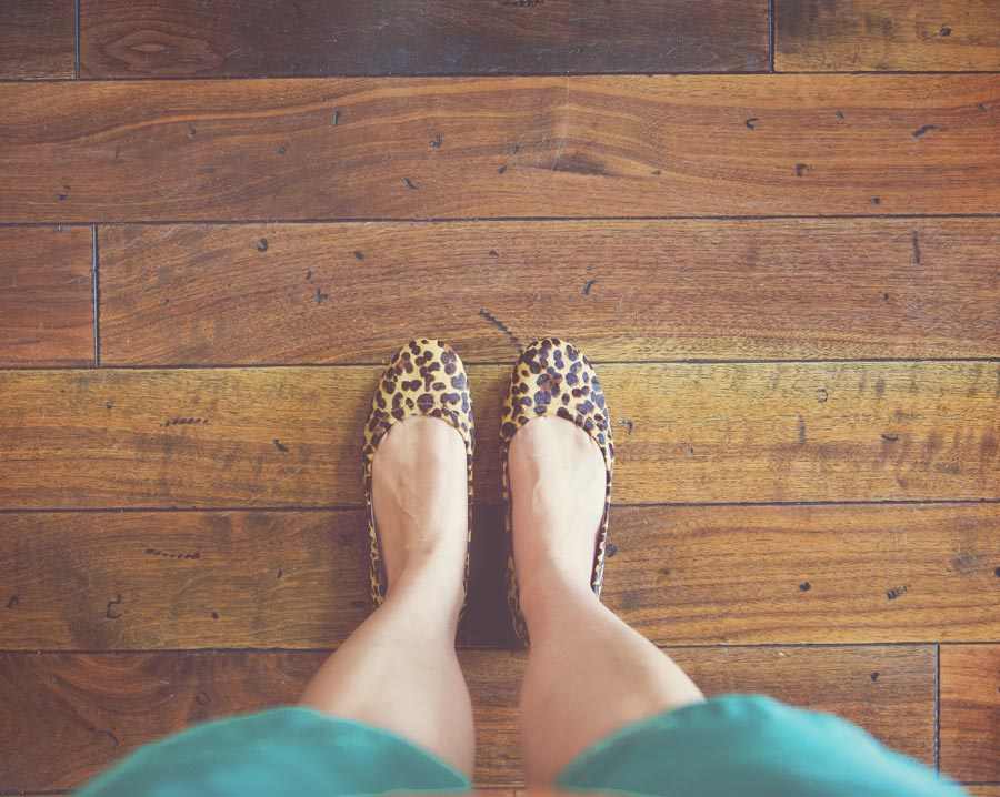 Woman wearing comfortable leopard print shoes