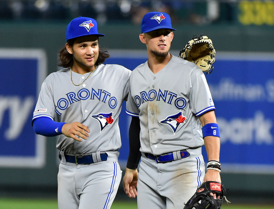 KANSAS CITY, MISSOURI - JULY 29: Bo Bichette #11 (L) and Cavan Biggio #8 of the Toronto Blue Jays celebrate a 7-3 win over the Kansas City Royals at Kauffman Stadium on July 29, 2019 in Kansas City, Missouri.