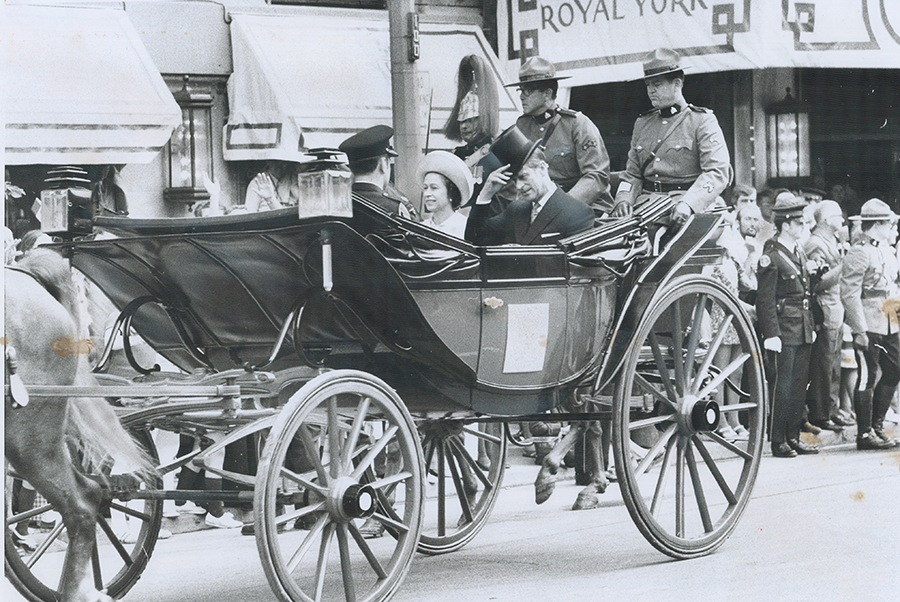 A photo of The Queen and Prince Philip passing by the Royal York in a carriage in 1973.