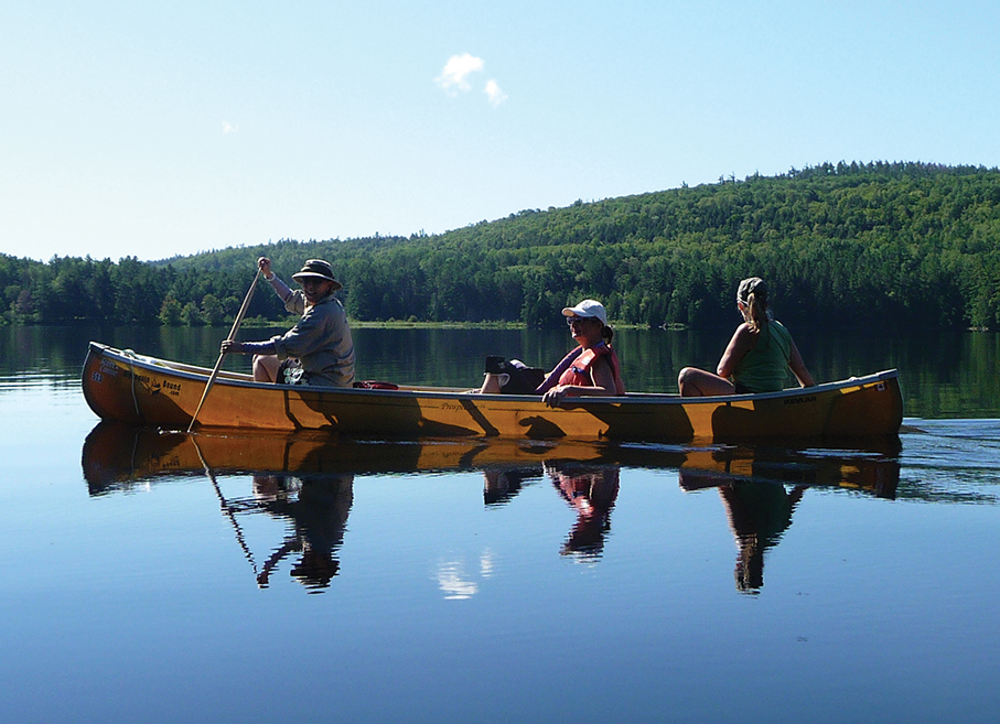 A photo of three women canoeing in Algonquin Park.