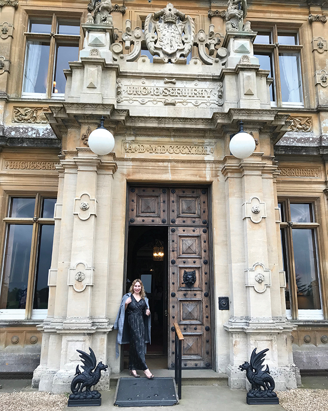 A photo of the author, Vivian Vassos outside of Highclere Castle.