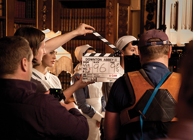 A behind the scenes photo of the filming during Season 2 of Downton Abbey.