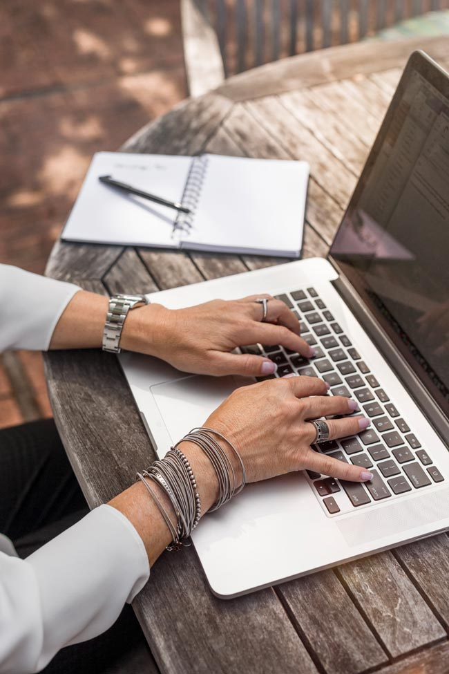 Busy woman working on laptop