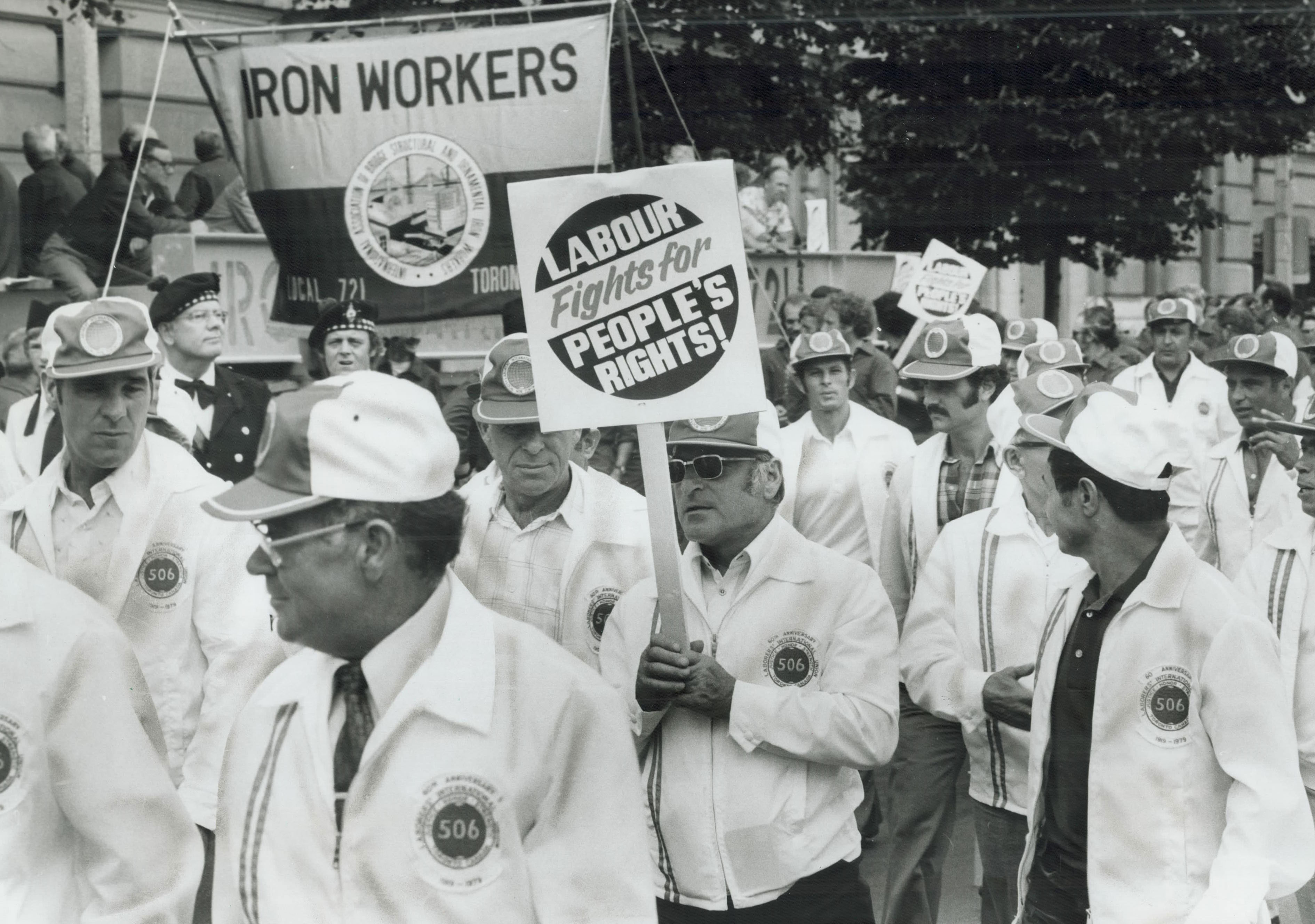 Labor day parade: Since 1886; Ontario workers have celebrated their day by marching together. In this 1979 photo; union members are shown attacking the provincial government's planned spending cutbacks.