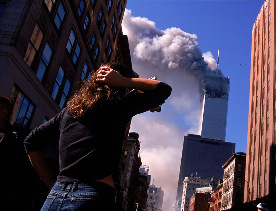 Shocked crowds of downtown Manhattanites observe the burning World Trade Center towers in New York City early September 11, 2001. Three hijacked planes crashed into major U.S. landmarks on the same day, destroying both of New York's twin towers and plunging the Pentagon in Washington into flames, in an unprecedented assault on key symbols of U.S. military and financial power.