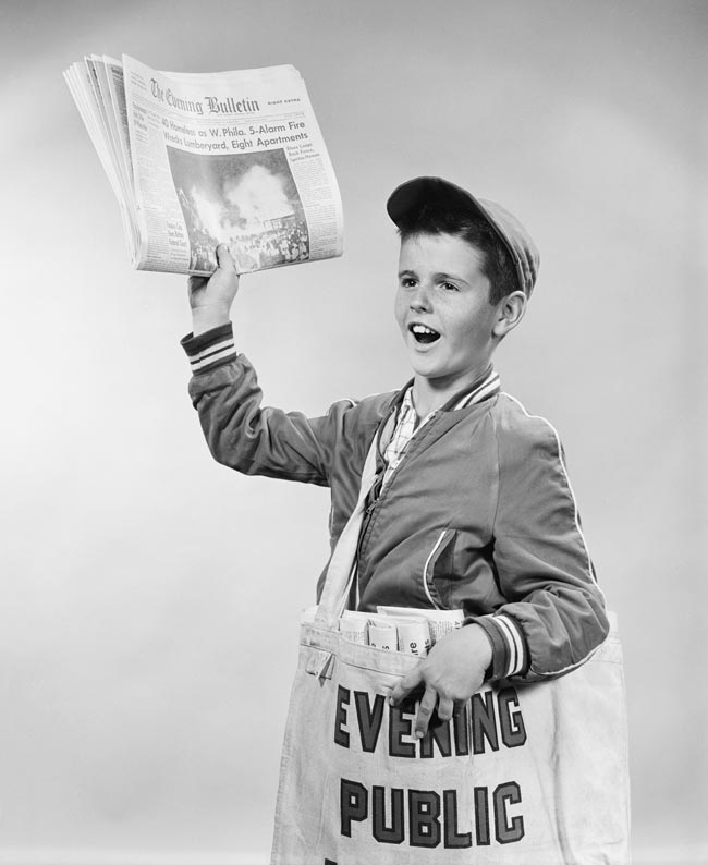 Nostalgic photo of a paperboy in the 1950s.