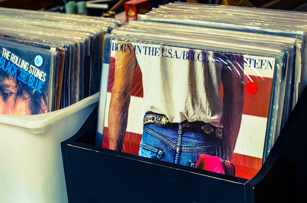 A bin of vinyl albums in a flea market