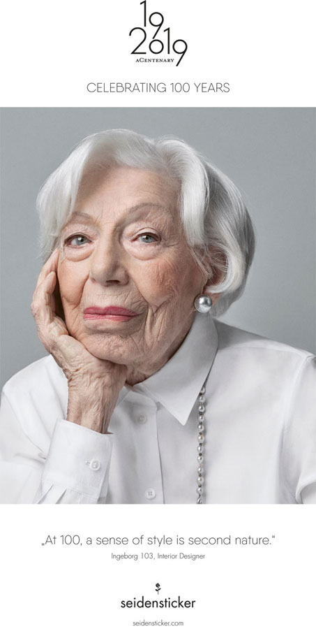 Ingeborg Wolf, 103, poses in a white dress shirt for Seidensticker's 100th anniversary ad campaign.