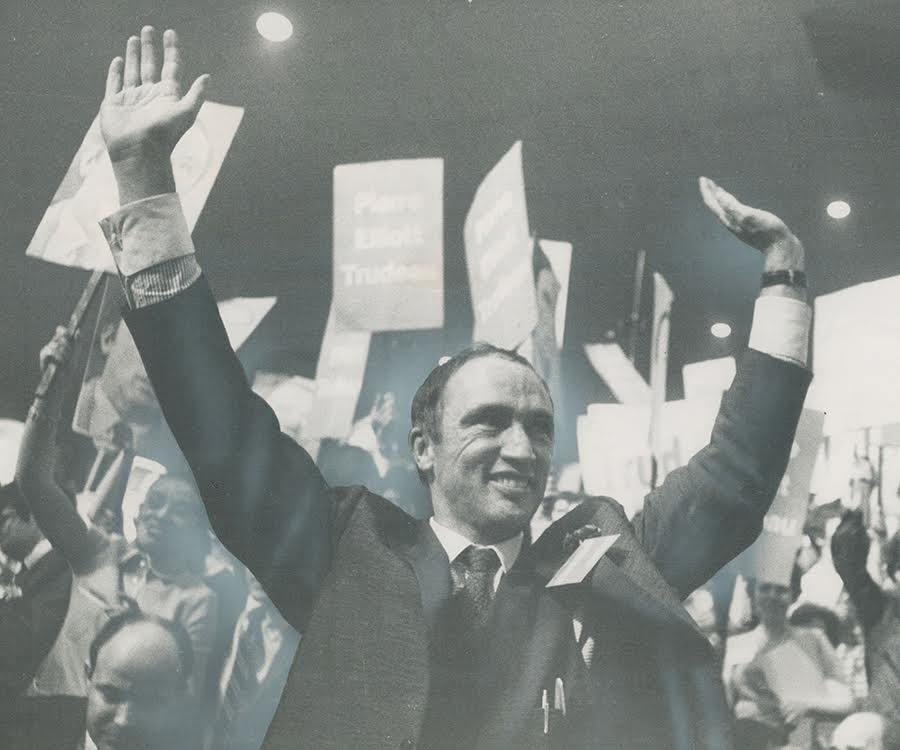 Pierre Elliott Trudeau gives onlookers a victory salute after he's named Prime Minister designate in Ottawa's Civic Centre.